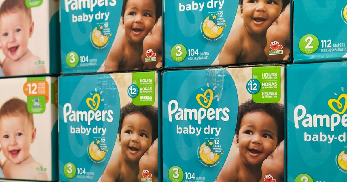 boxes of pampers baby dry diapers on store shelf