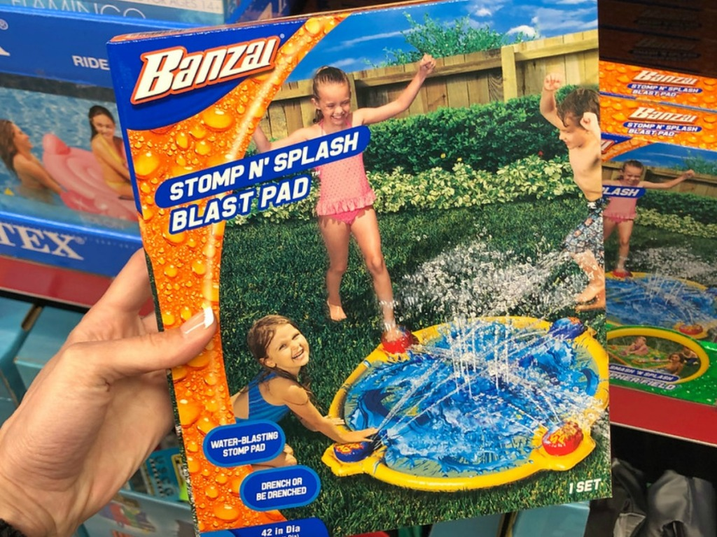 box with sprinkler toy and splash pad for kids
