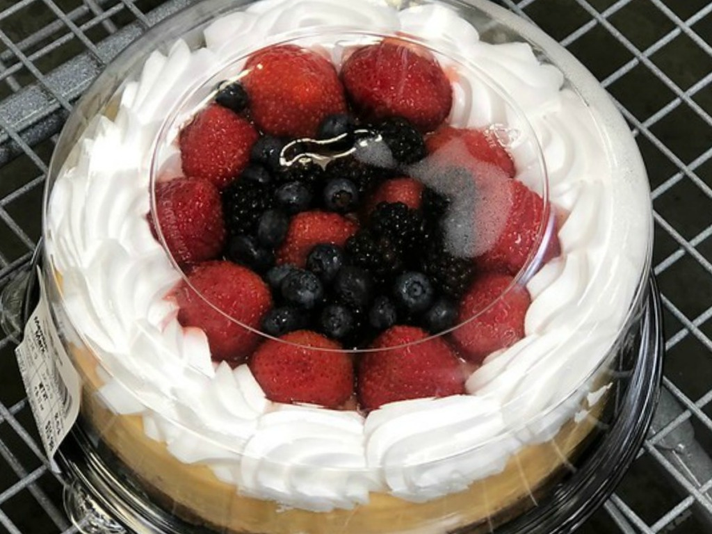 cake topped with strawberries and blueberries