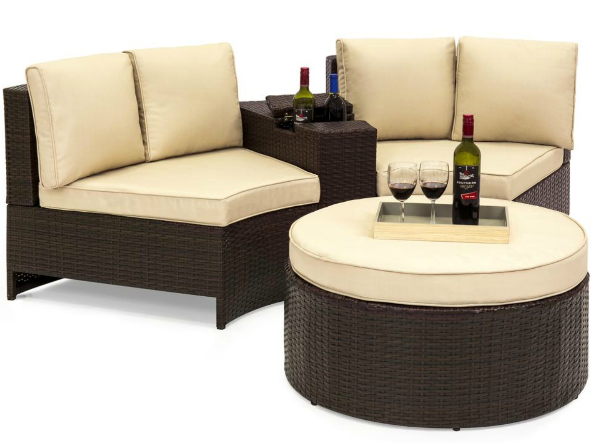 4 pc wicker set with wine on table and ottoman
