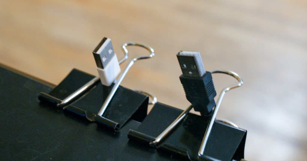 binder clips holding charging cords in place