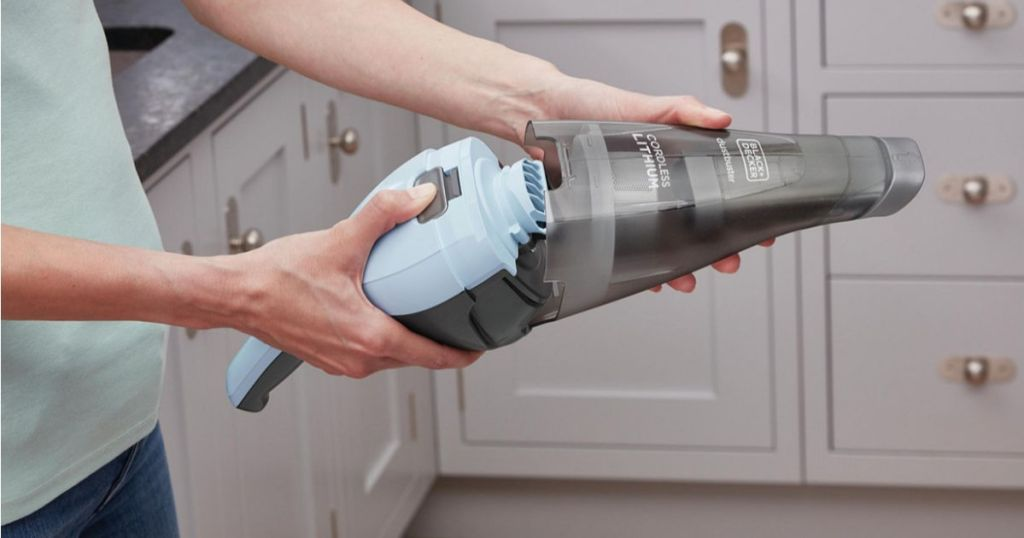 woman opening up black and decker ice blue handheld vacuum