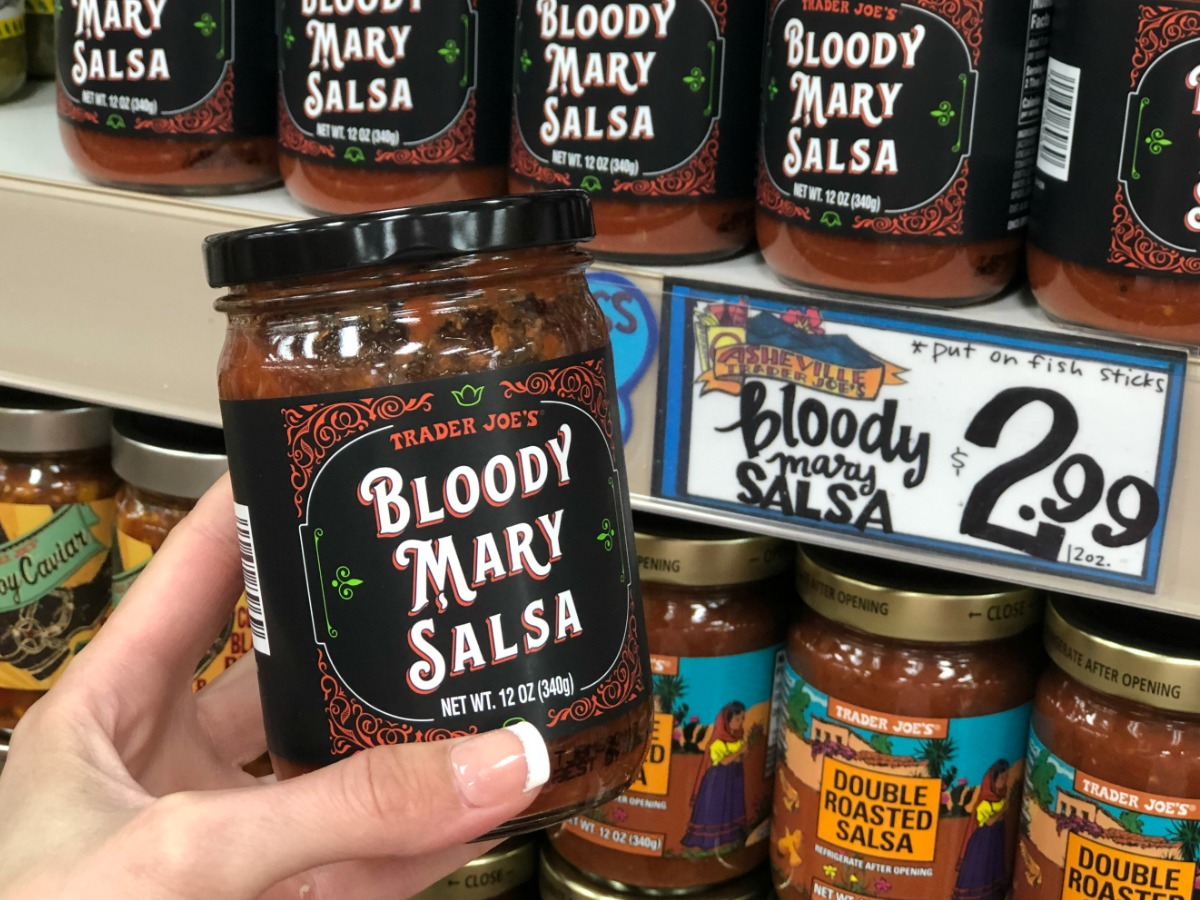 hand holding jar in store labeled bloody mary salsa