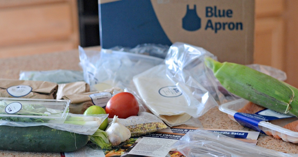 blue apron box and assortment of ingredients