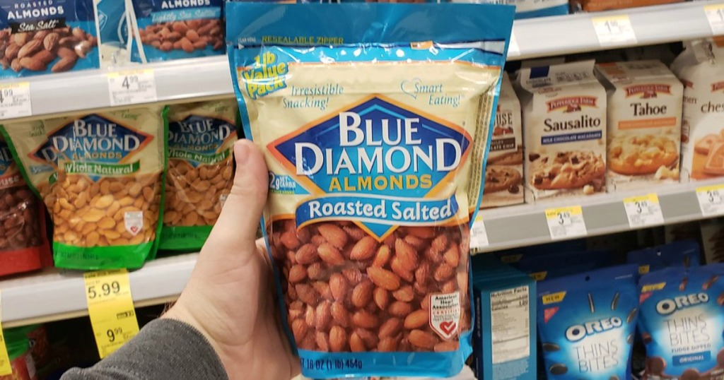 hand holding bag of almonds in a store