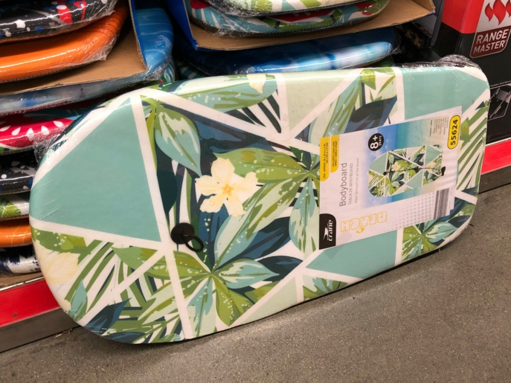 floral patterned body board by store display