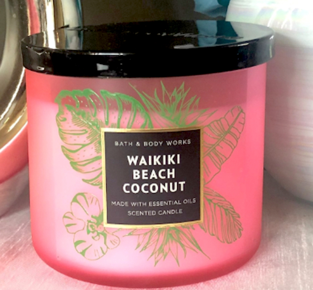 pink waikiki coconut candle with black lid