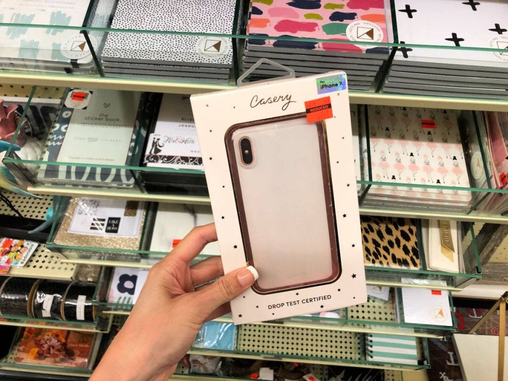 Woman holding casery iphone x rose gold case in hobby lobby