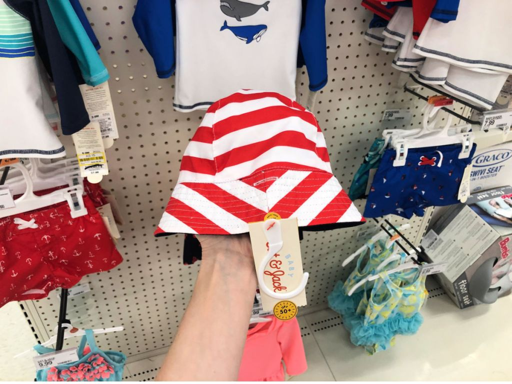 woman hand holding red and white cat & jack bucket hat in target