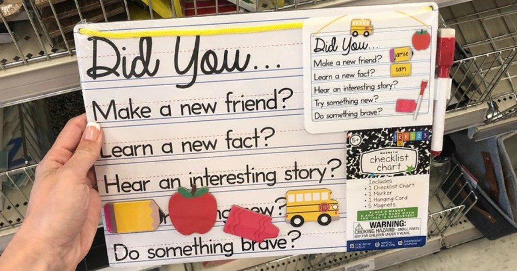 hand holding chart for kids to write in by store display