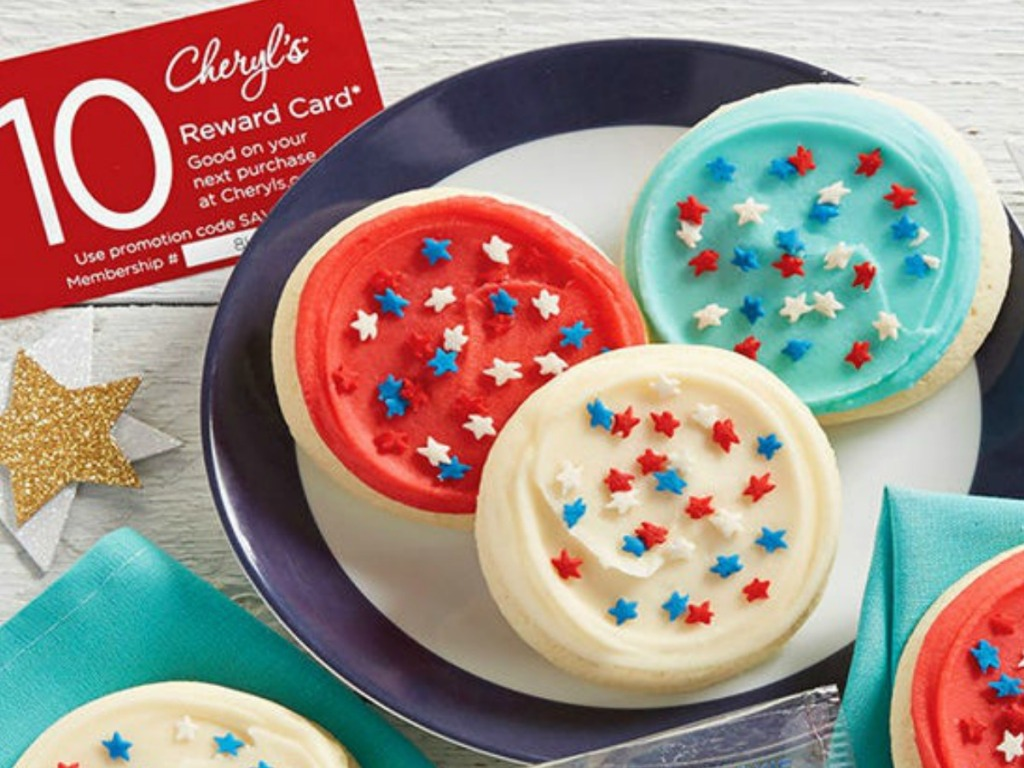 cheryl's cookies $10 reward card sitting by plate of red white and blue cookies with star sprinkles