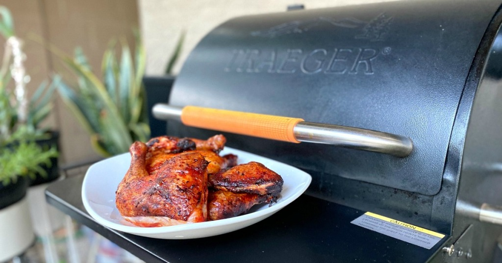 chicken in front of a traeger
