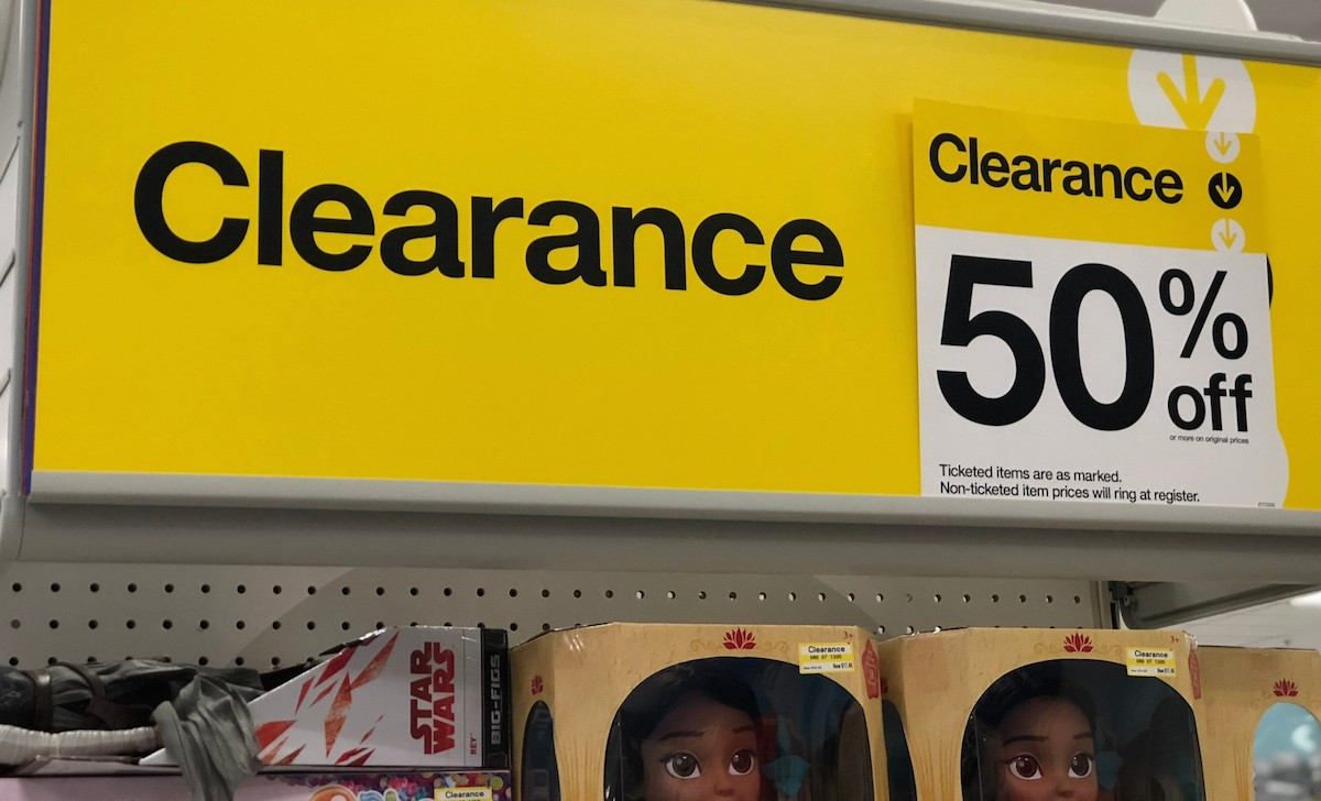 yellow clearance sign with 50% off tag