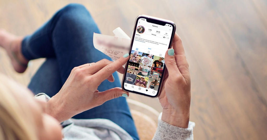 woman looking at hip2save instagram page