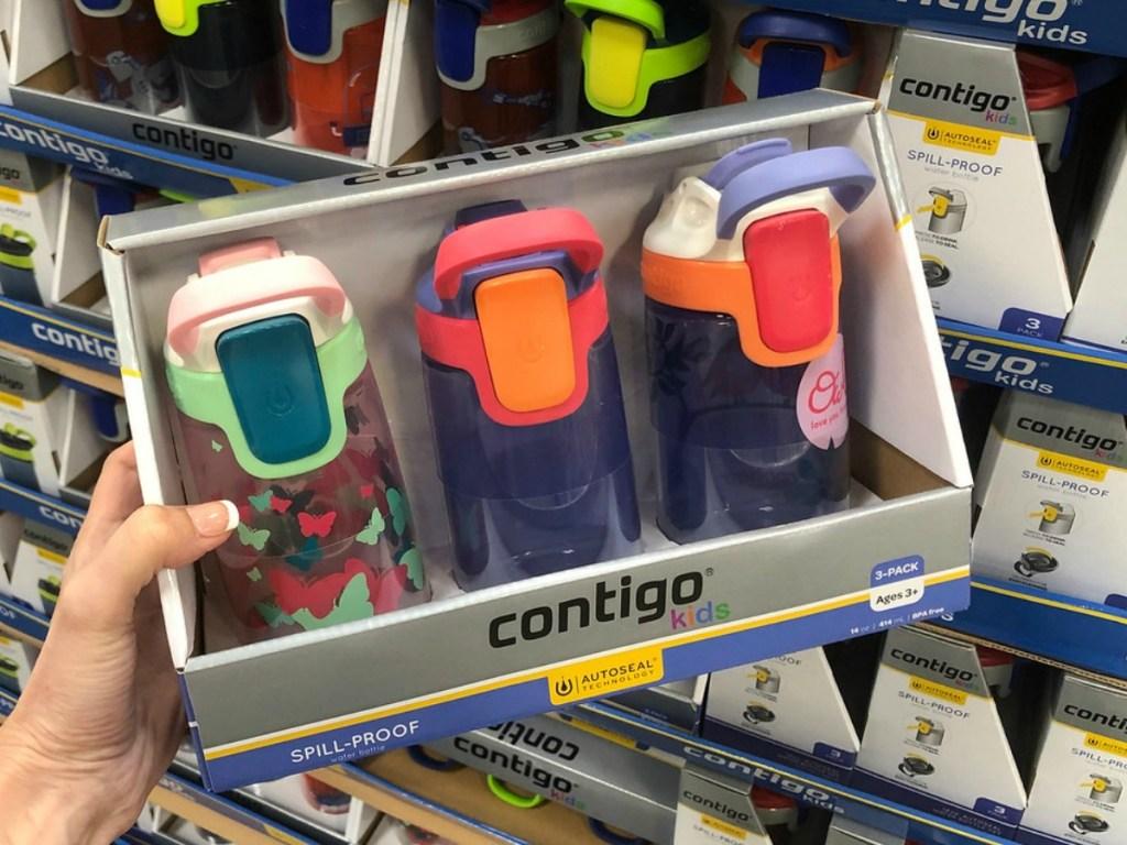 three colorful kids waterbottles in packaging in store