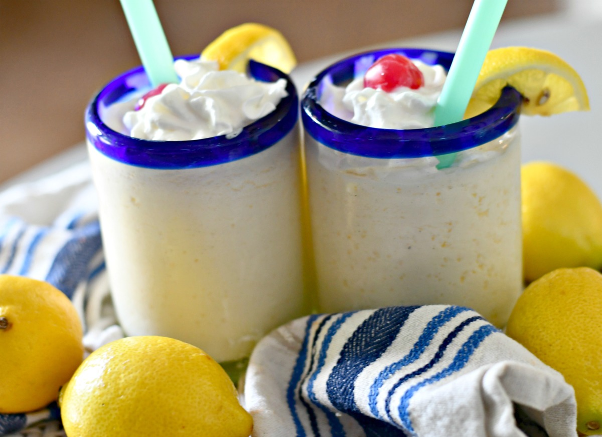 2 creamy frosted lemonades on the table with straws