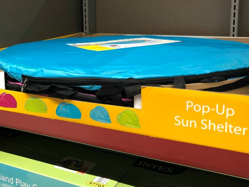 box on store shelf with blue pop up shelter tent