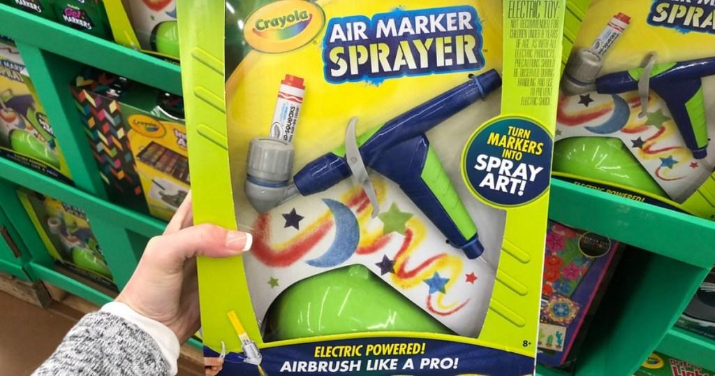 hand holding crayola air marker sprayer
