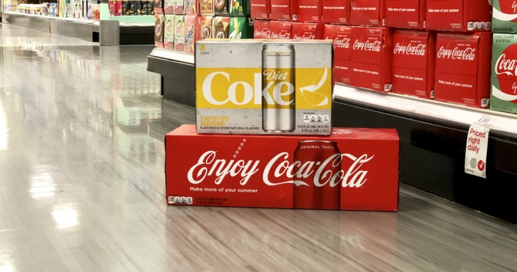 coca-cola 12-pack on store floor with diet coke twisted mango on top