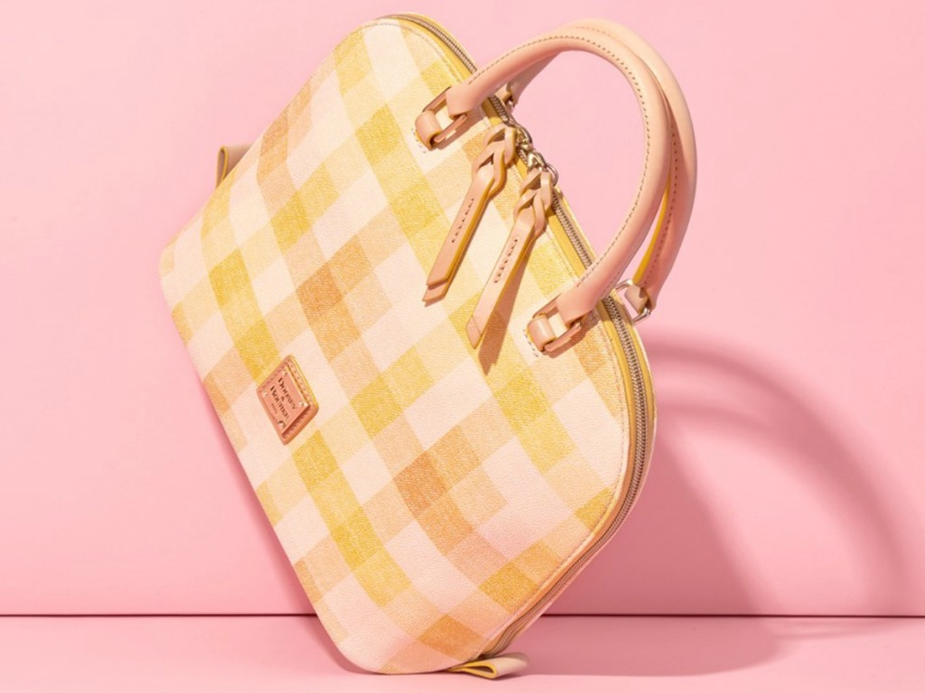 yellow and white checkered purse on pink background