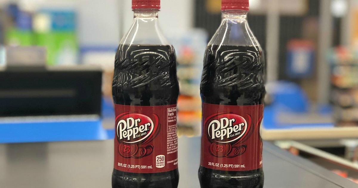 two Dr. Pepper bottles sitting on shelf