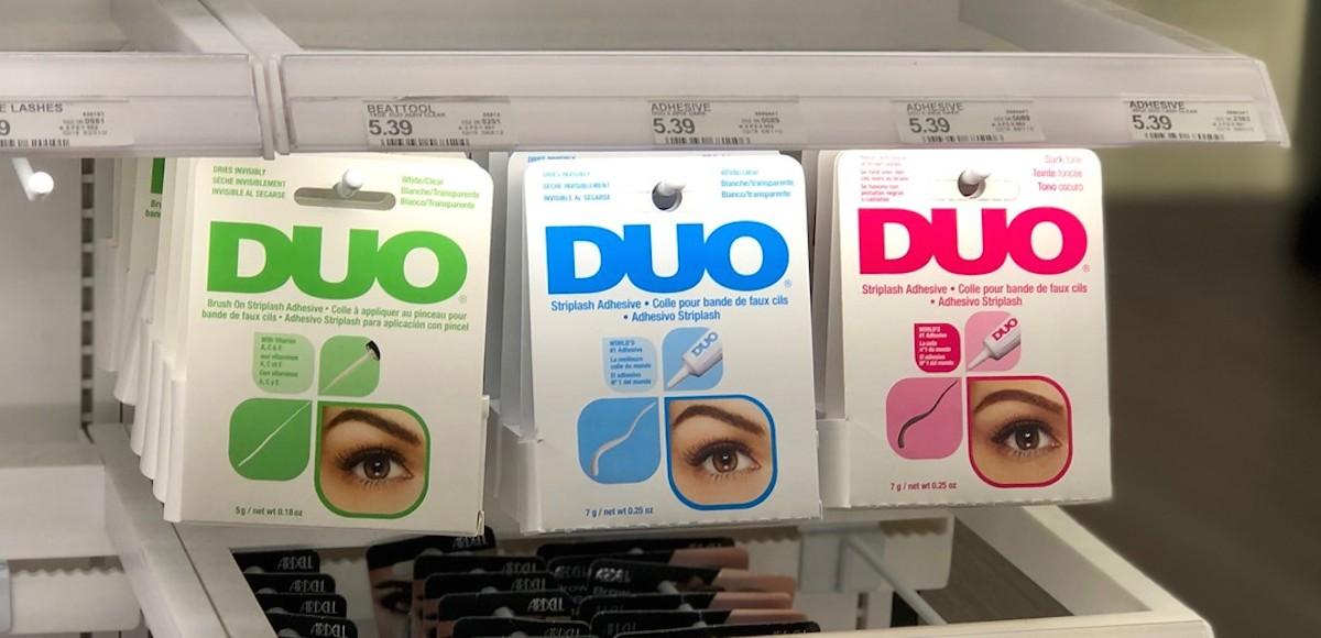 duo eyelash glue lined up on store shelf