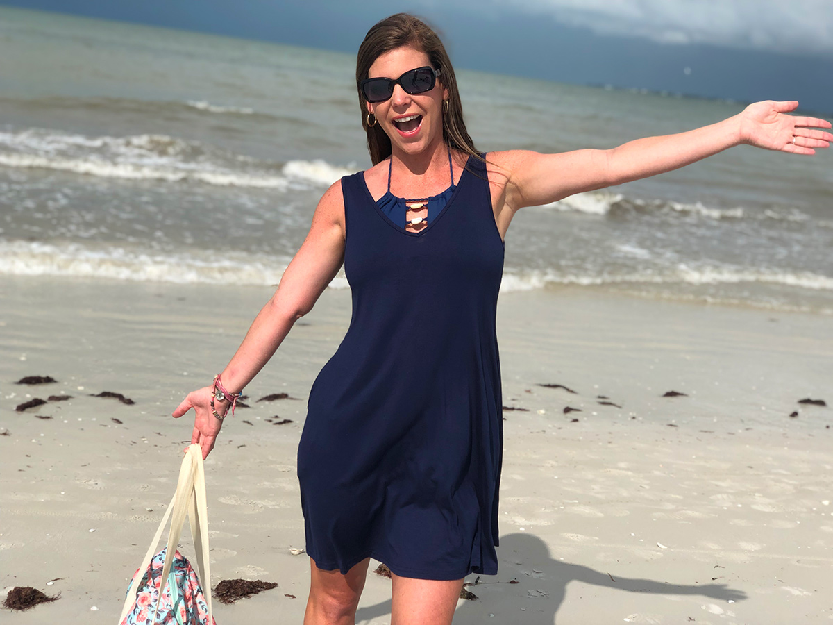 woman wearing swim cover up dress at the beach