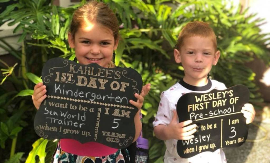 girl and boy ready for first day of school with chalkboards