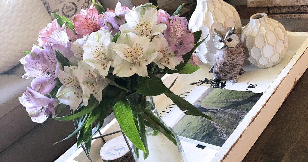arrangement of flowers and decor on coffee table