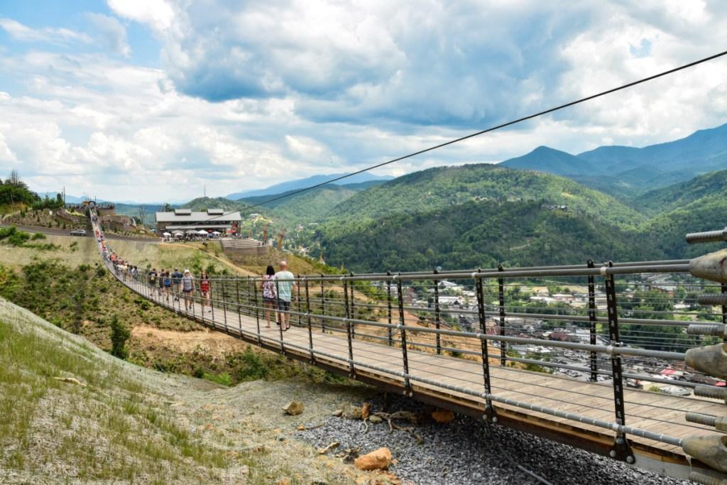 people walking across suspension bridge in gatlinburg tennessee