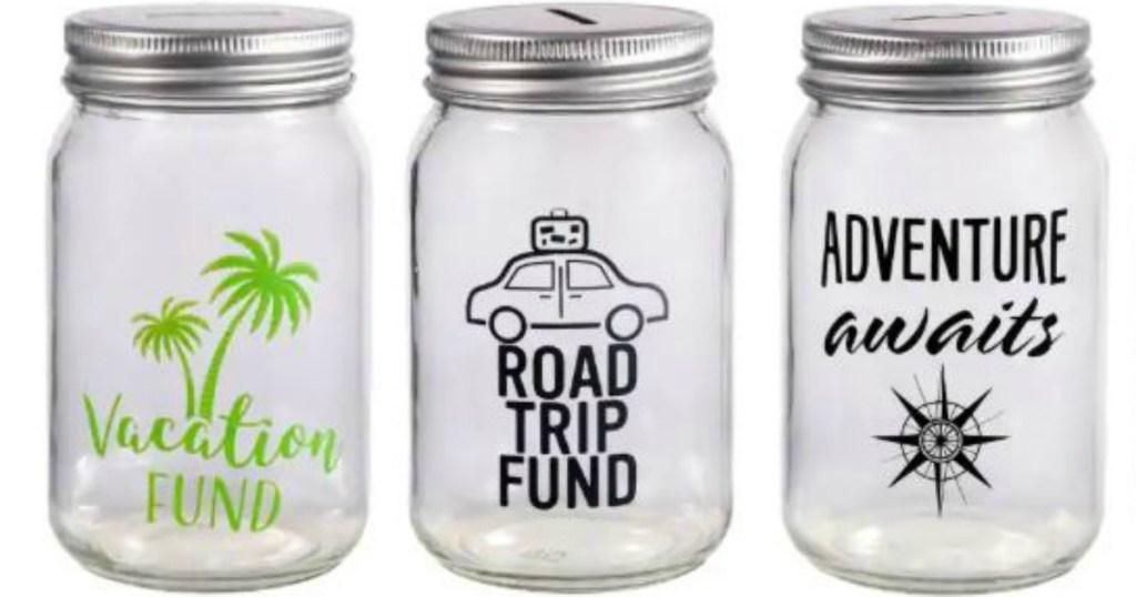 three glass jars made into banks