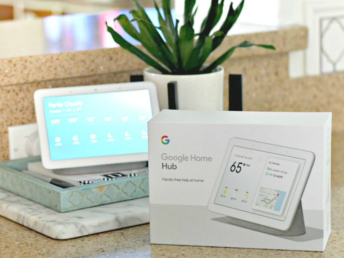 google home hub on the counter with the box