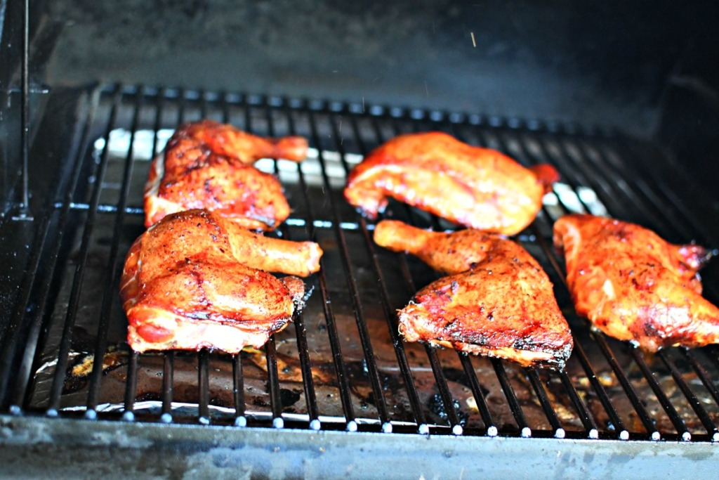 grilled chicken quarters on a traeger grill