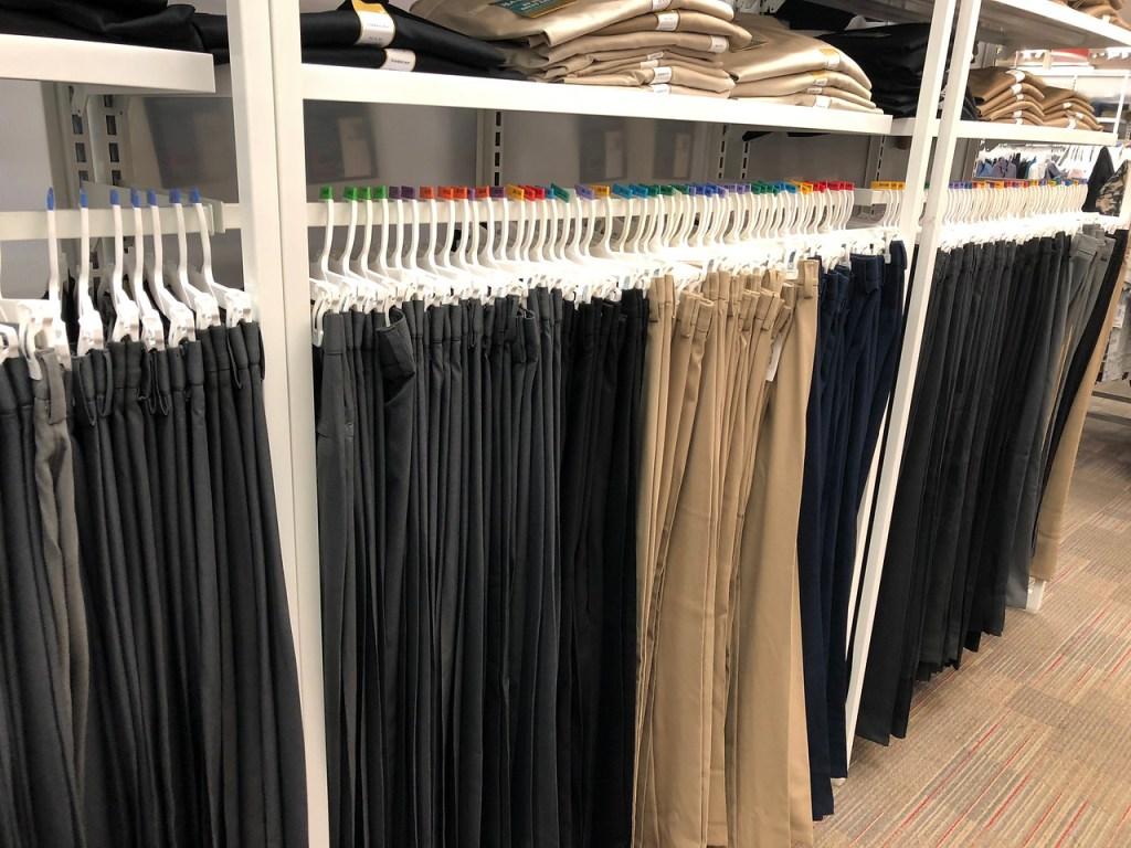 racks with different color men's dress pants.jpg