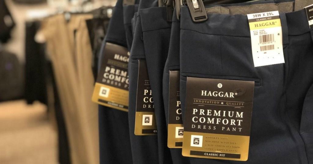 men's dress pants in blue on hangers