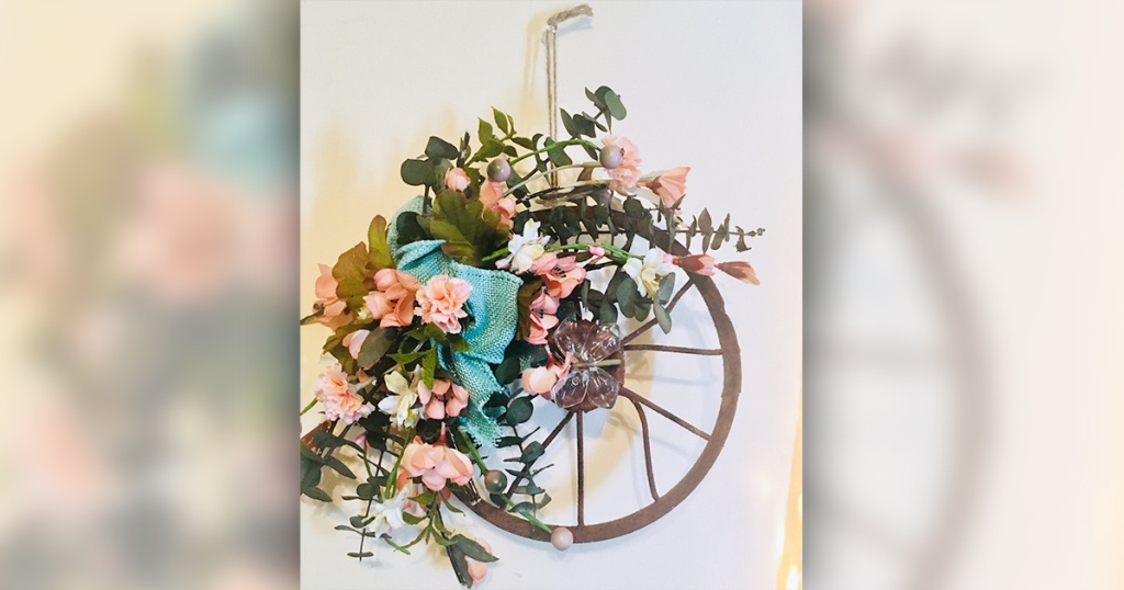 flower wreath on antique wheel