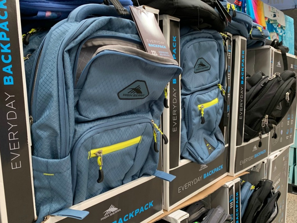 display of blue and black backpacks in store