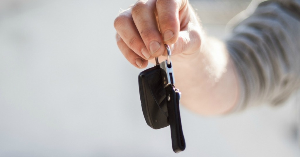 holding car keys