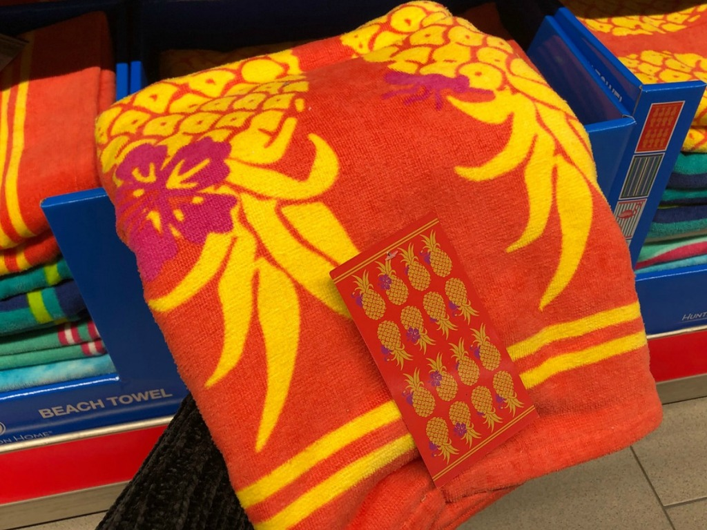 orange beach towel with pineapples on it