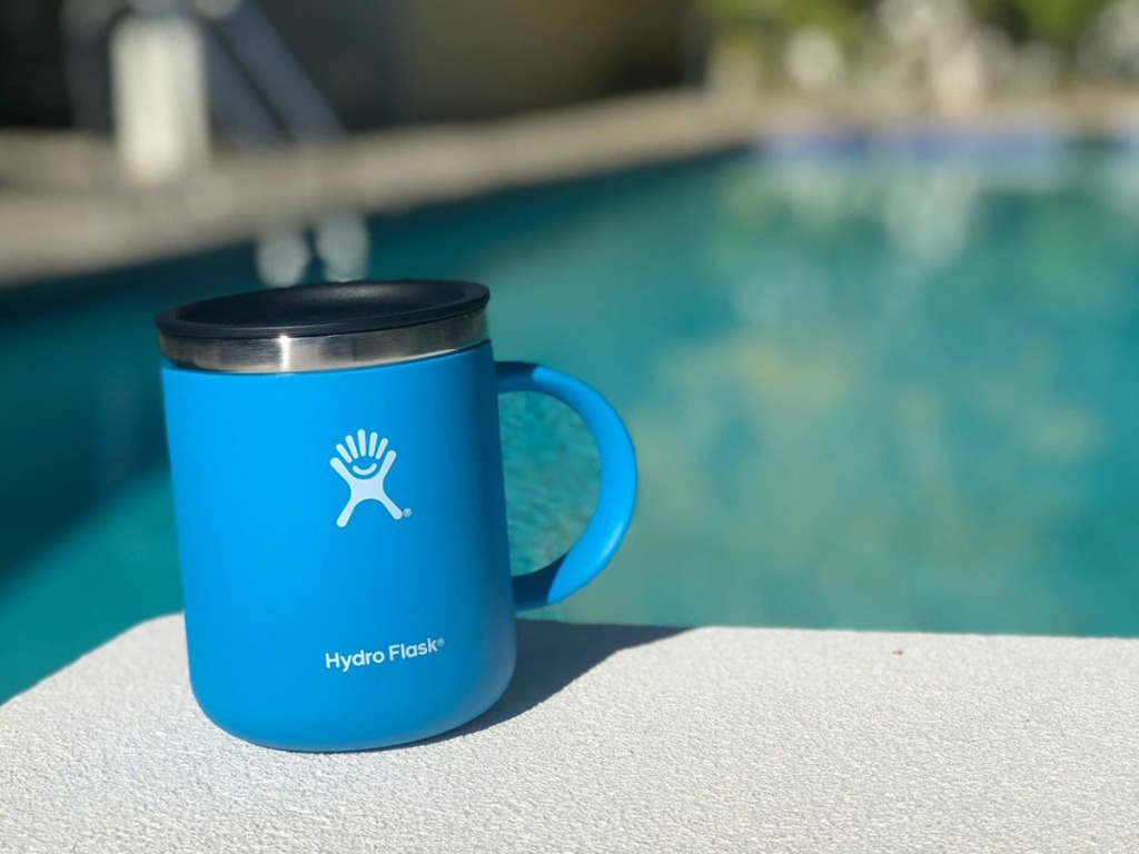 blue coffee mug outside by pool