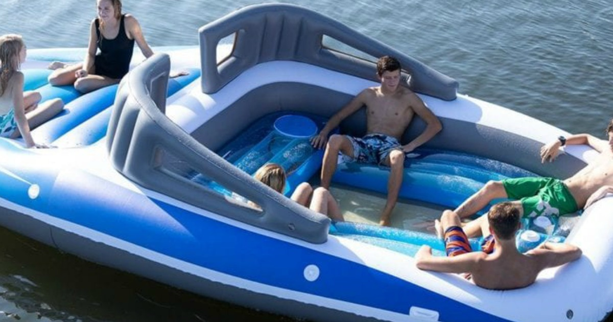 inflatable speed boat float with people in the boat in the water