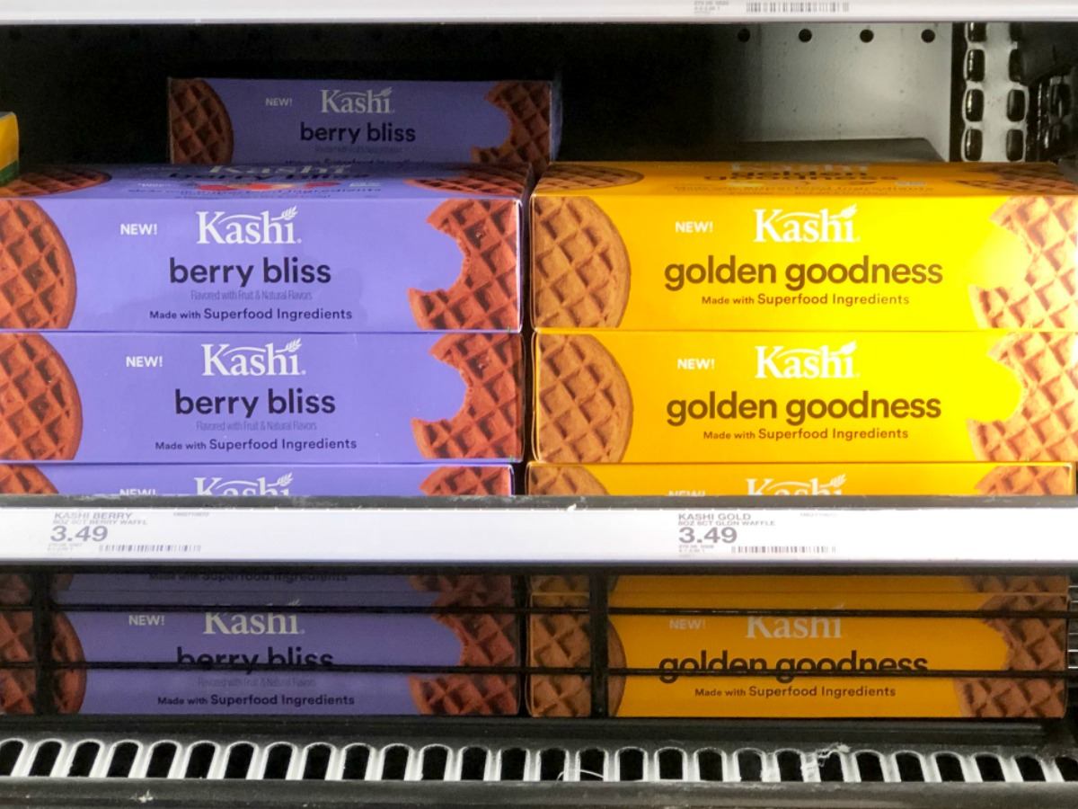 frozen Kashi waffles in a store freezer with prices