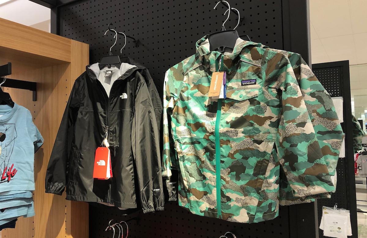 black north face jackets and camo patigonia coats hanging on racks