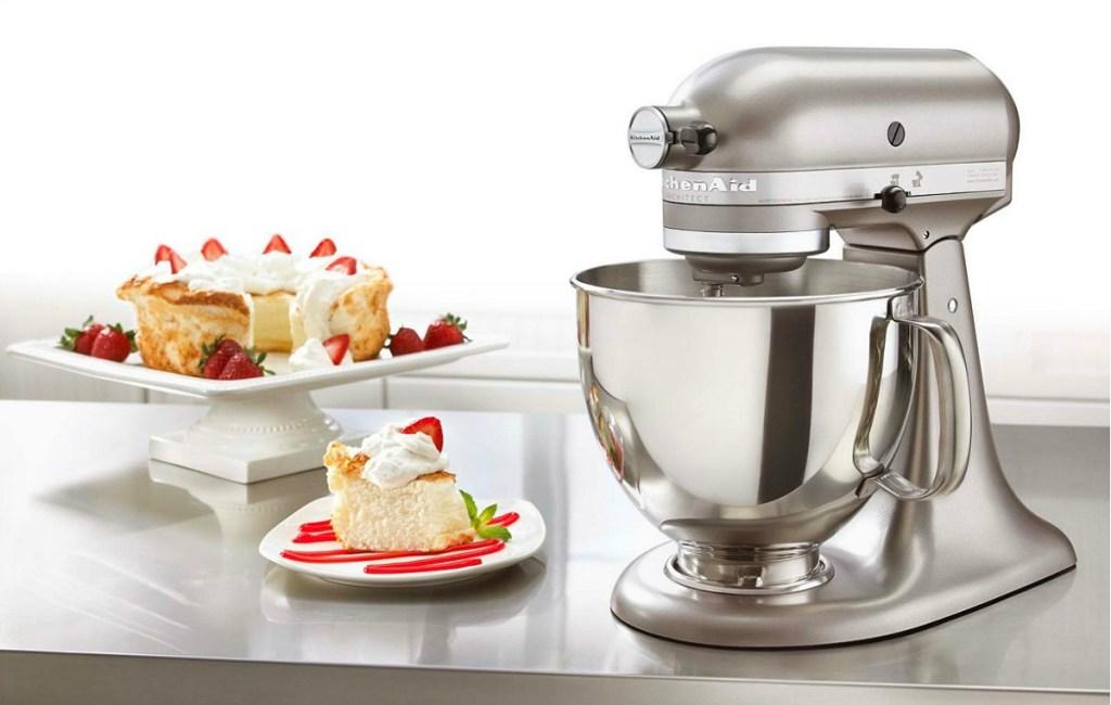 kitchenaid architect series stand mixer sitting next to cake
