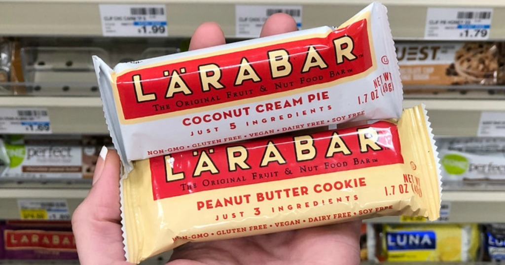 hand holding two larabar bars in store