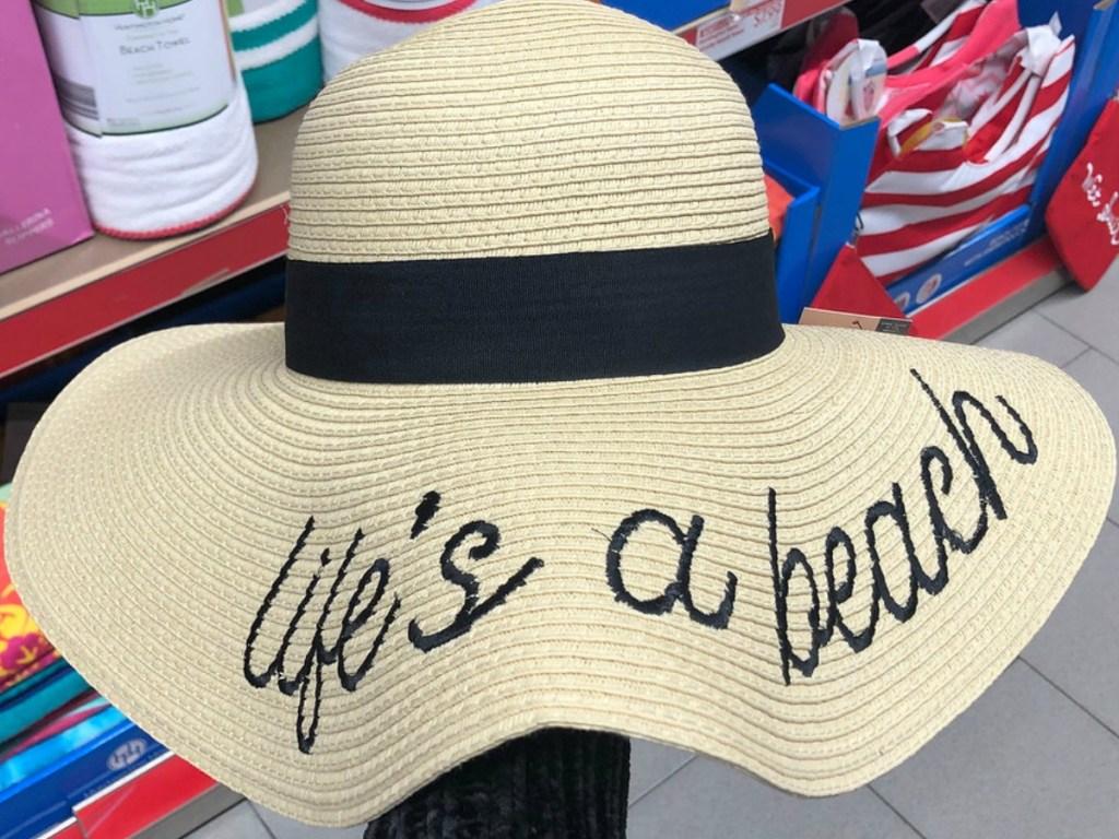 "sun hat that says ""life's a beach"" in cursive"