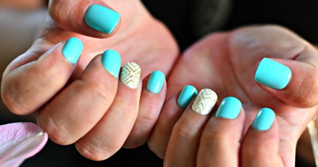 wearing light blue impress nails