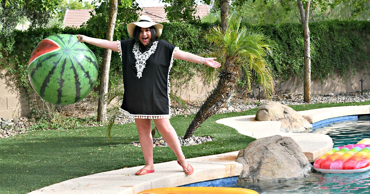 woman wearing black coverup by the pool