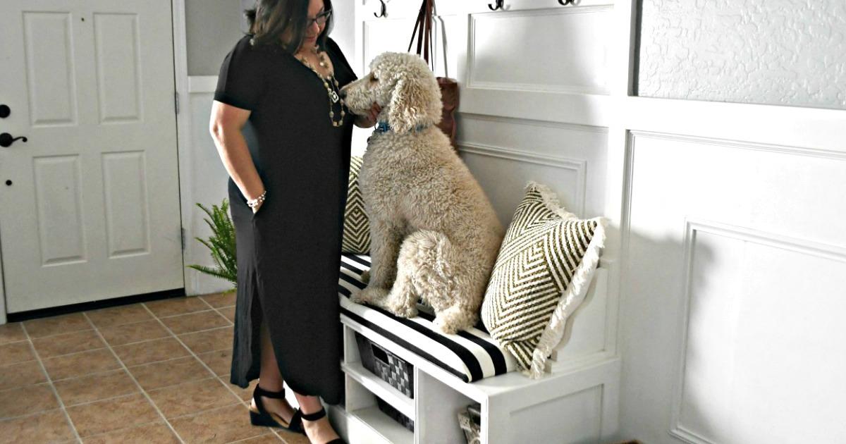 woman wearing long black maxi dress petting dog