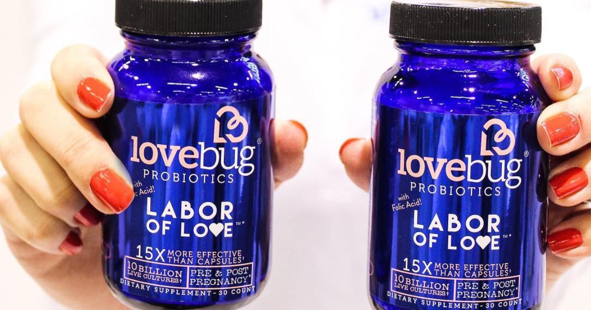 woman holding lovebug probiotics labor of love bottles